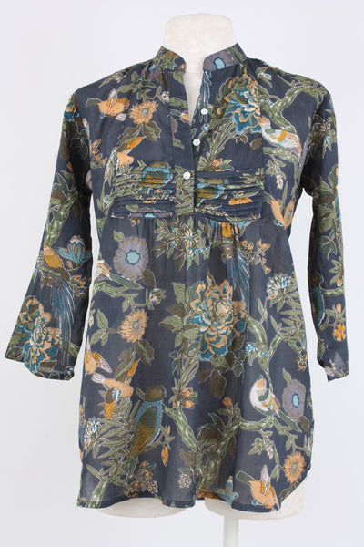 Pleated front tunic with a colorful floral print.