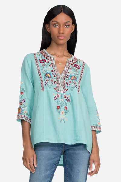 In a beautiful shade of Marine Blue, the Johny Was Nya Weekend Top with it's Embroidered Floral Detail, is Sure to be a Favorite all Season Long, Available at Village Vogue.