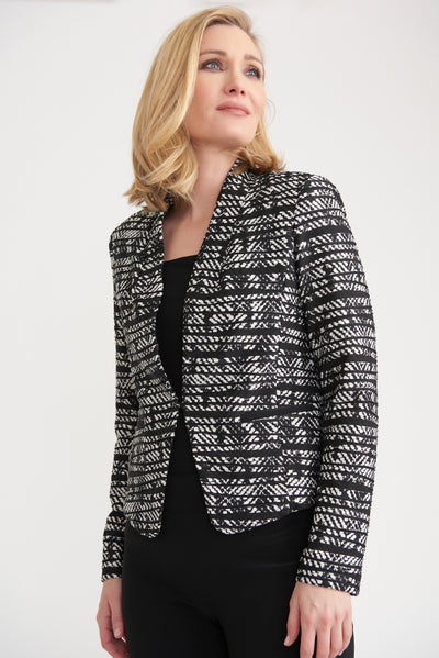 Black and white jacquard print jacket with a tuxedo collar and long sleeves.