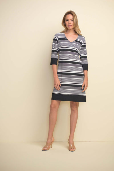 Joseph Ribkoff Striped Dress Style 211199 with a V-neck and 3/4 sleeves available at Village Vogue.