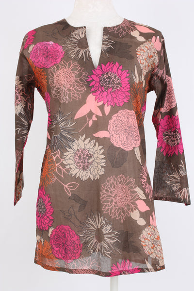 Flower print tunic in pink multi with a split neck.