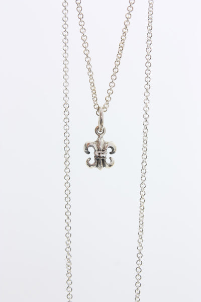 Village Vogue sterling silver Fleur de Lis charm necklace.