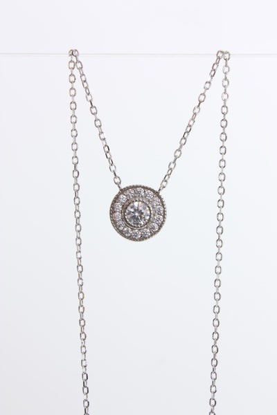 Sterling silver halo style necklace with cubic zirconia Village Vogue