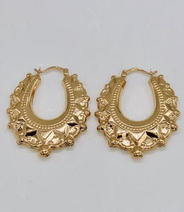 Yellow gold large fancy creole earrings