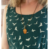 Layla Amber Wooden Acorn Necklace Model