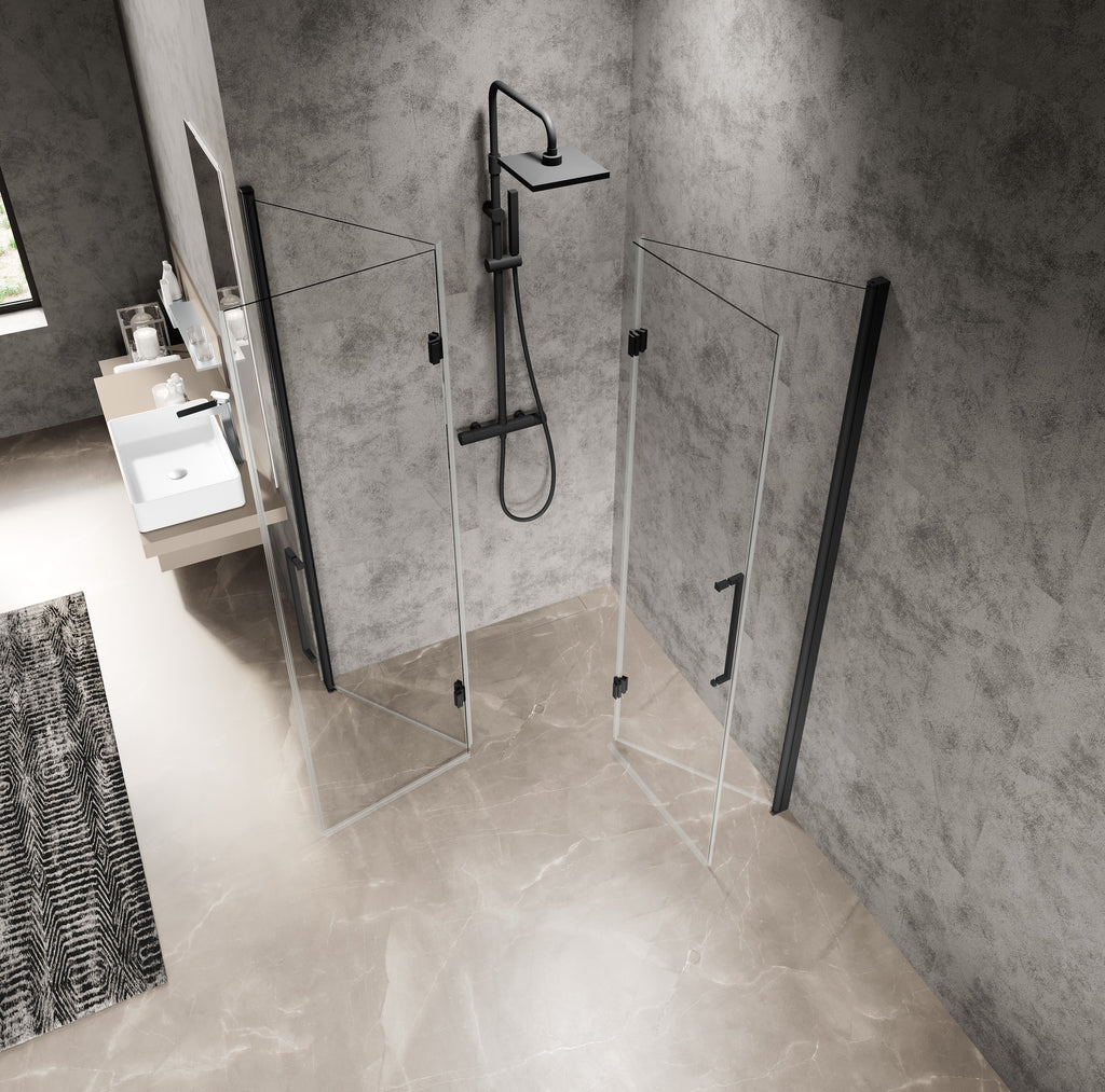 An aerial view of a corner glass shower enclosure with matt black handles in a step free wet room