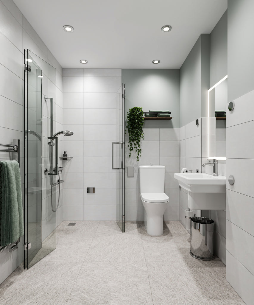 After. Modern light grey tiled accessible wetroom with shower enclosure doors open and folded flat against the walls
