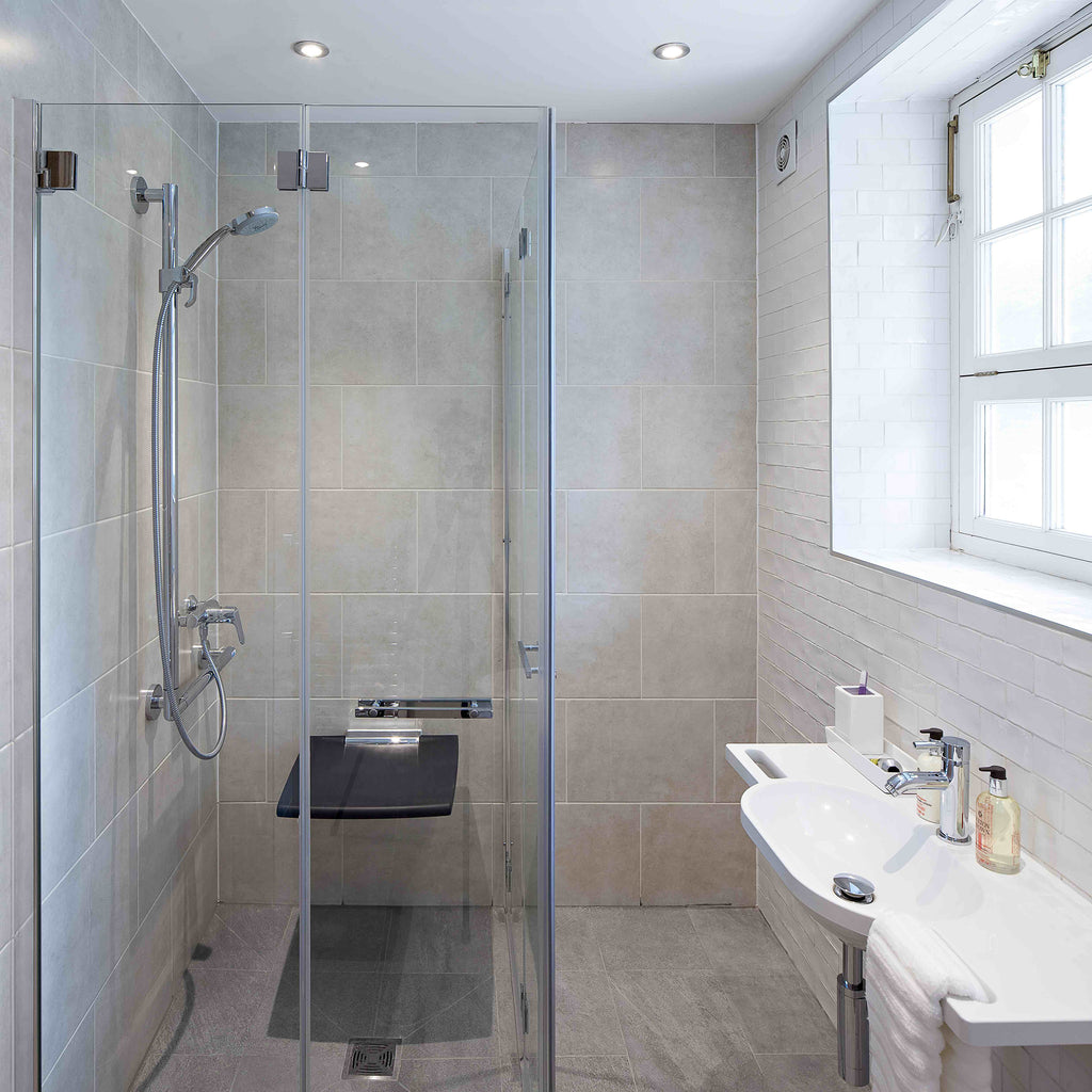 Kate's new accessible shower enclosure with closed glass bi-folding doors.