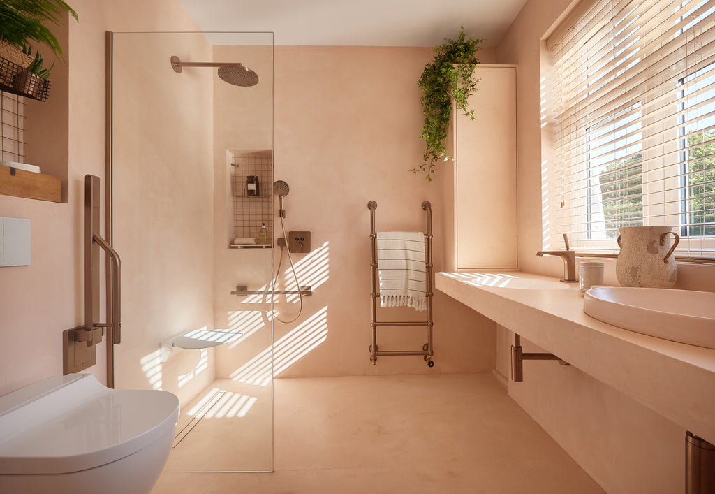 A muted pink accessible wet room