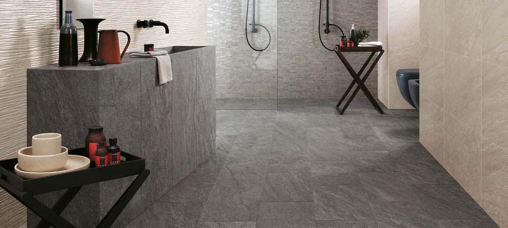 Bathroom with grey slip-resistant floor tiles in a modern style.