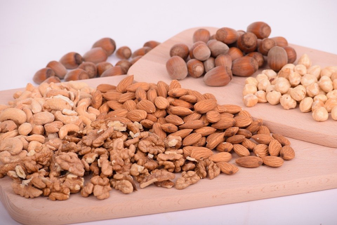 Almonds, Walnuts, Cashews, and Other Nuts on Wooden Boards