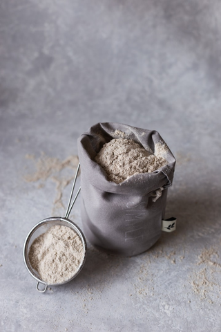 Flour placed in a bag and a strainer