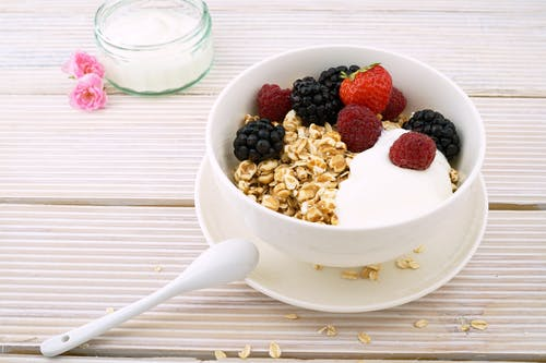 Oatmeal in A Ceramic Bowl Containing Oats, Nuts, and Berries
