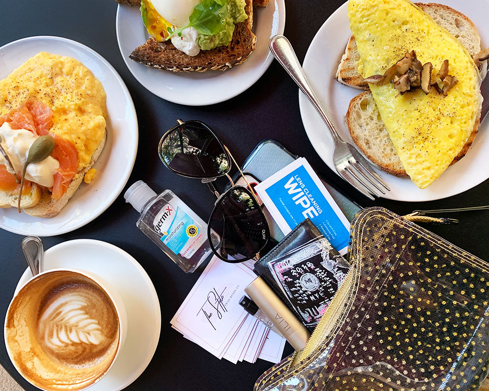 Delia's bag spilled on the brunch table at Buvette in NYC