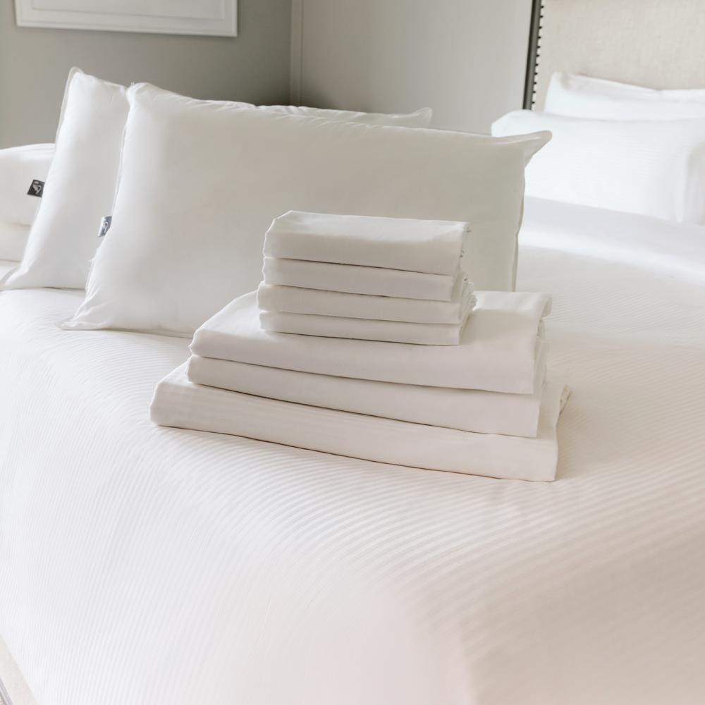 Folded sheet set and pillows on The Fairmont Bed