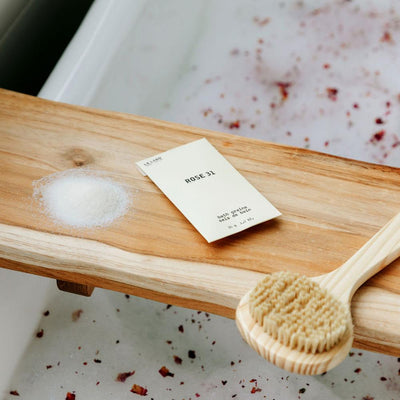 Le Labo Rose 31 Bath Salts on tray in bath tub