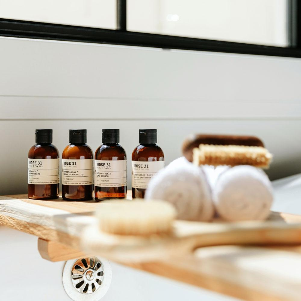 Le Labo Rose 31 travel size bottles on bath tub