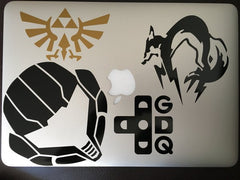 GDQ cross Foxhound Hyrule Crest and Samus Vinyl Sticker Decal on macbook