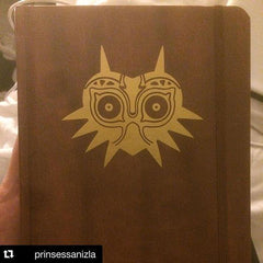 Gold Majoras Mask Vinyl Sticker Decal on moleskin