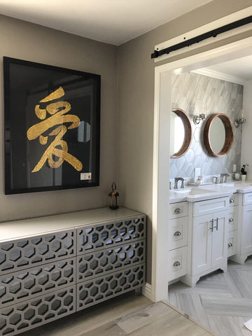 Modern-style interior with white-and-gray bathroom, geometrical design bureau in beige and gray, wall art in black and gold