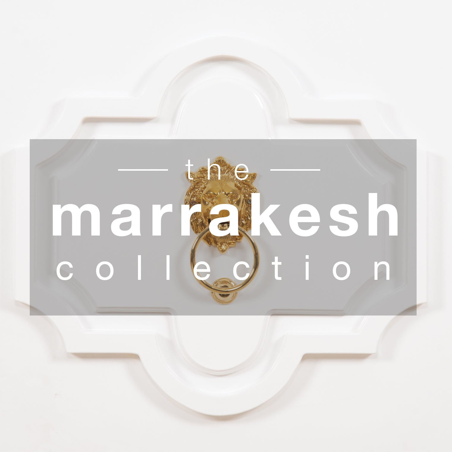Ornate white door with gold lion door knocker and 'the Marakesh Collection' in white letters on shaded center rectangle