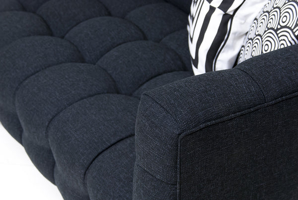 Close up of tufting black sectional