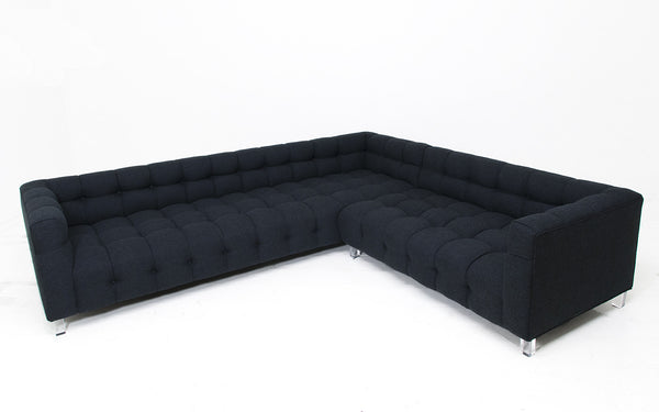 Tufted black sofa without pillows