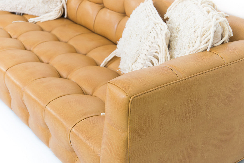 delano sofa in lizardo fawn faux leather