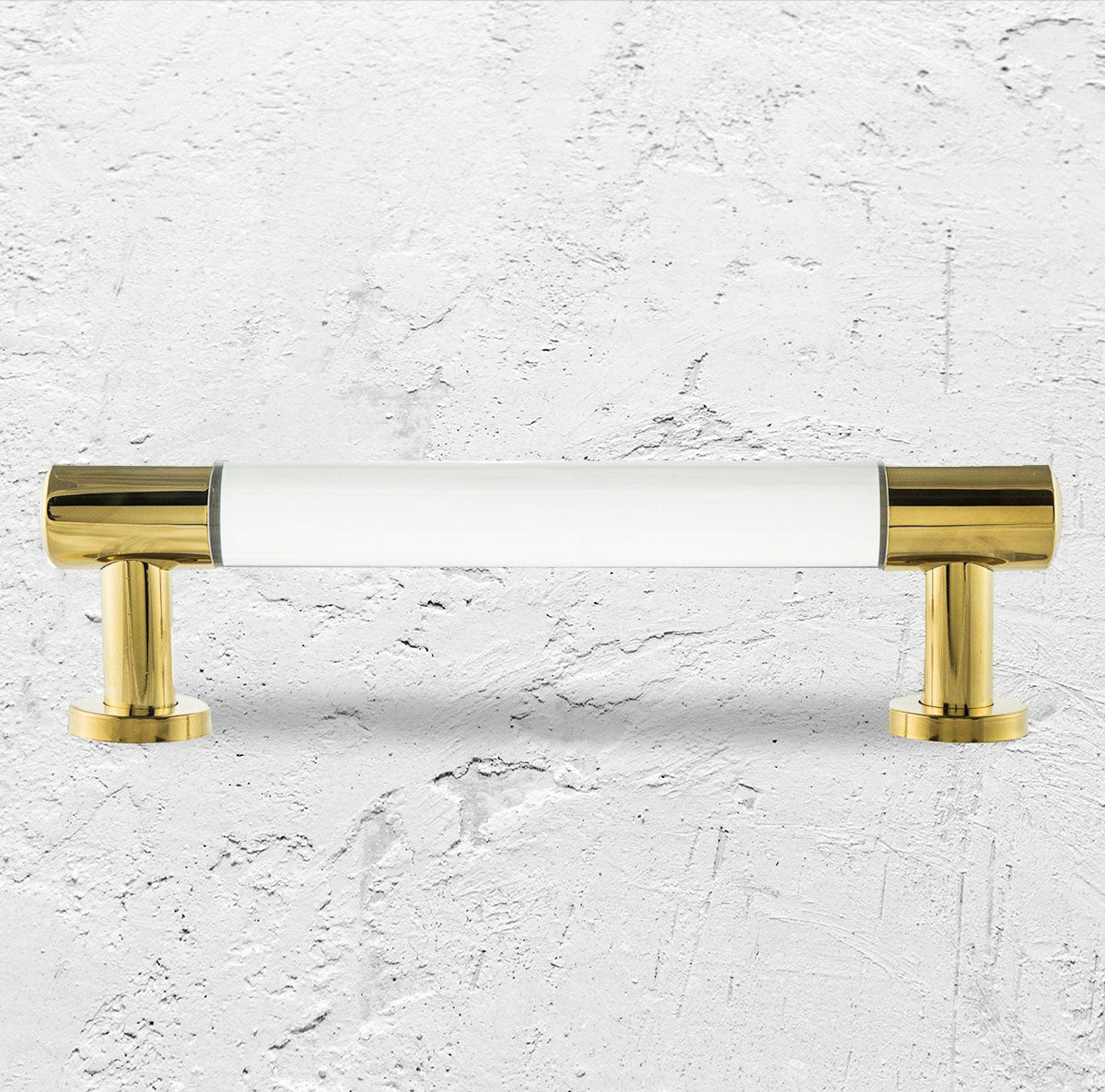 Round brass bar pull with Lucite accent piece in the center of the handle.