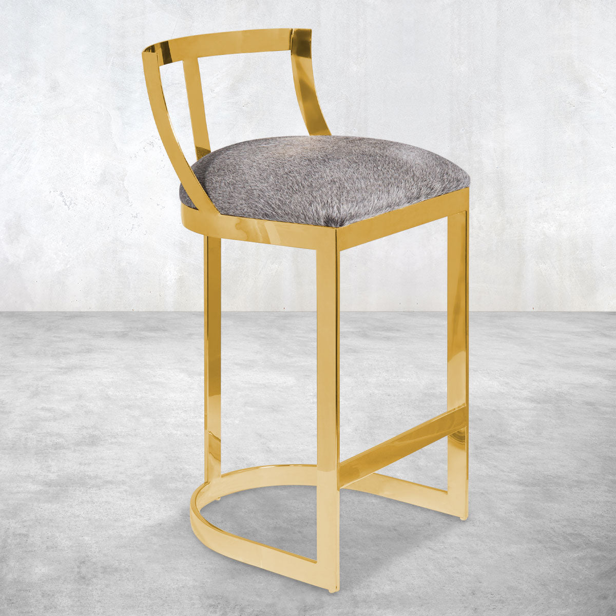 Polished brass bar counter stools with an open, brass framed back, a U-shape rounded base and plush gray upholstered seat.