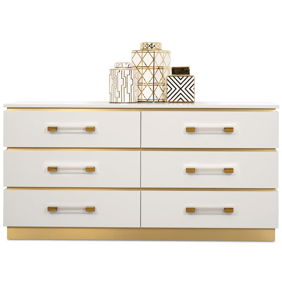 Six-drawer dresser with a brushed brass frame, pedestal base, white drawer fronts and Lucite drawer pulls.