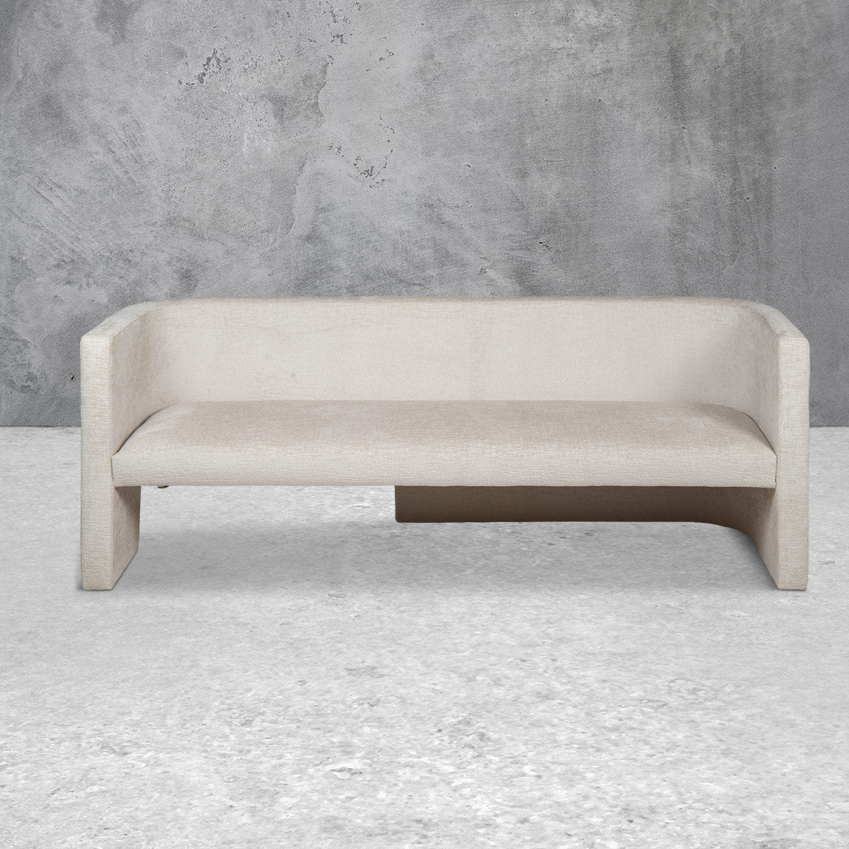 Bench style loveseat sofa with a mid-rise back, a single cushion, straight edges, a half-open base and light beige upholstery.