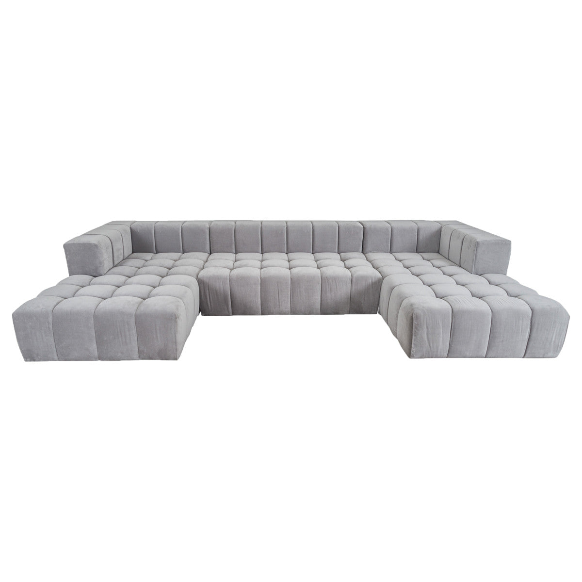 Modular light gray upholstered sectional sofa with double chaise lounges, a low back, straight sides, button tufted cushions and a channel tufted back.