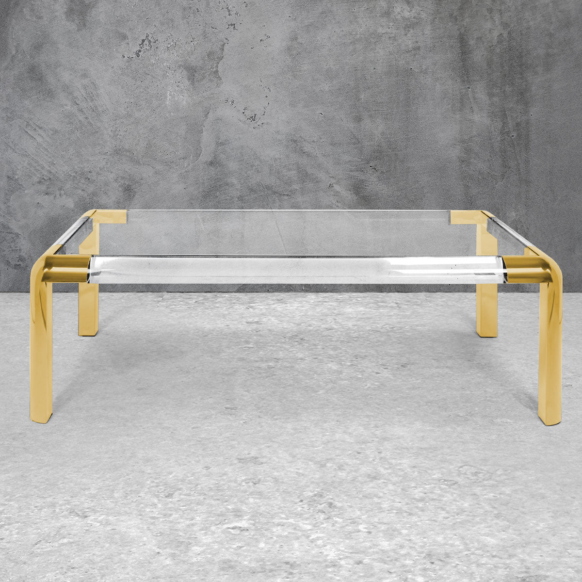 Modern rectangular coffee table with curved brass corners, brass legs and a Lucite top.