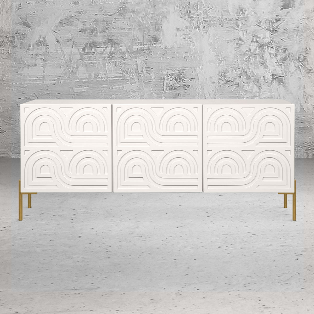 Three section credenza with decorative design on the front panels, a white finish and brushed brass legs.