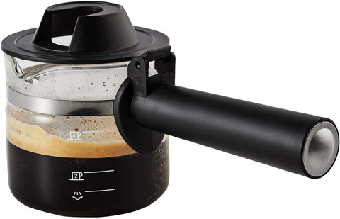 glass carafe with cool touch handle, containing freshly brewed coffee