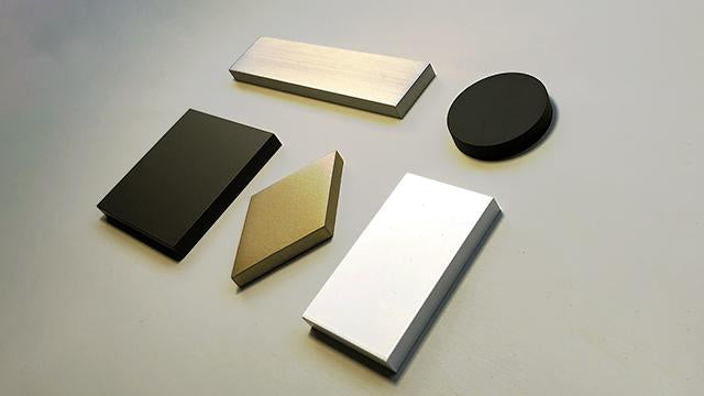 finishes: brushed aluminum, matte black, dark bronze, matte brass, white