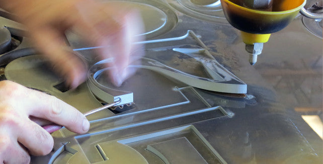 Waterjet cutting in action!  Your numbers, being cut precisely.
