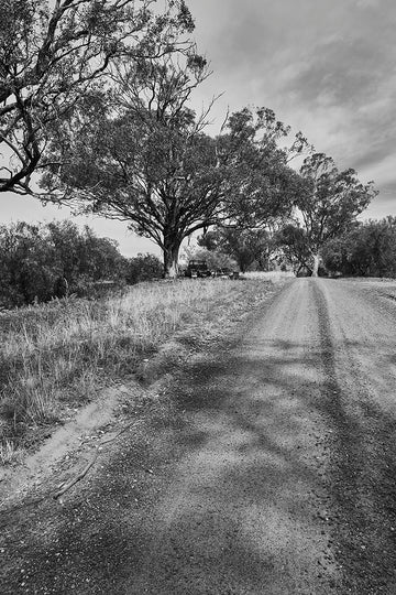 'Broken Trucks' Dusty Road Black & White Photographic Print