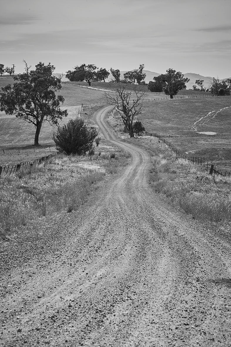 'Follow The Winding Road' Dusty Road Black & White Photographic Print