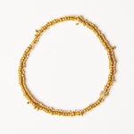 gold beaded bracelet w/diamond bead