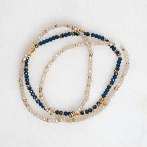 gold + crystal stretch bracelets in navy/black
