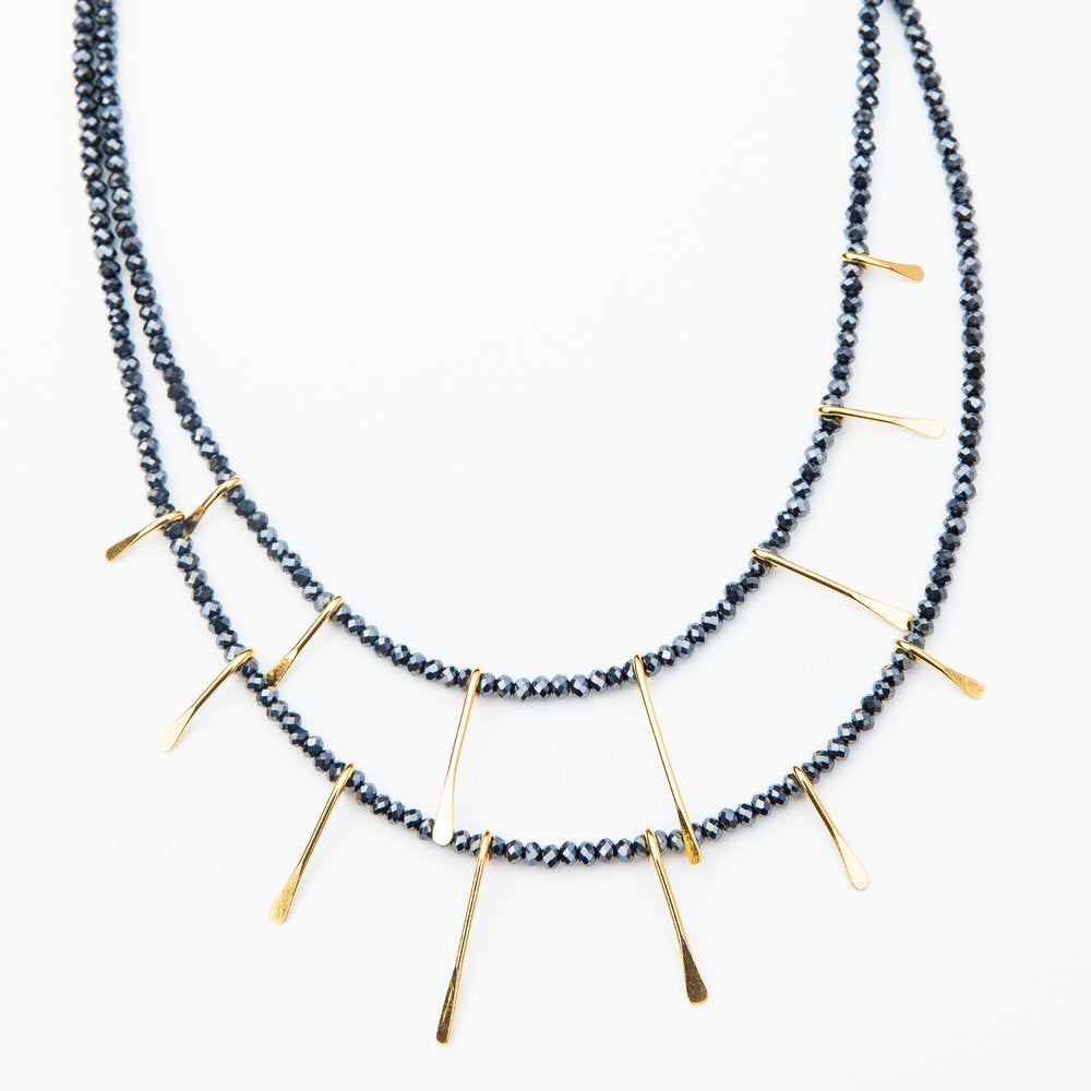 gold paddle necklace in navy/black