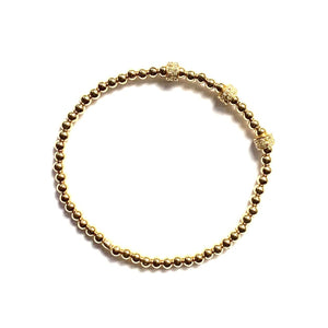 Pave diamond and gold ball stretch bracelet