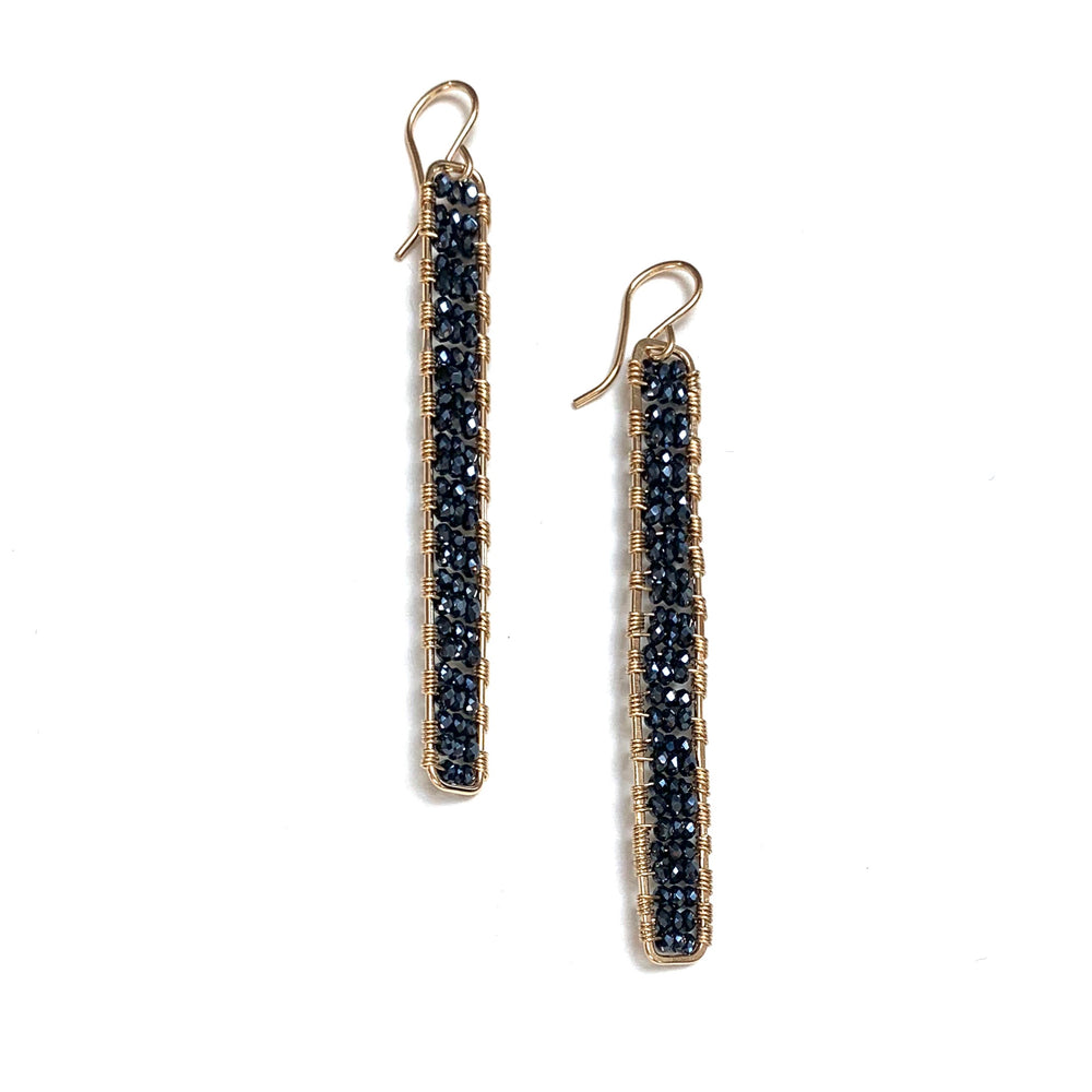 gold stick earrings in midnight