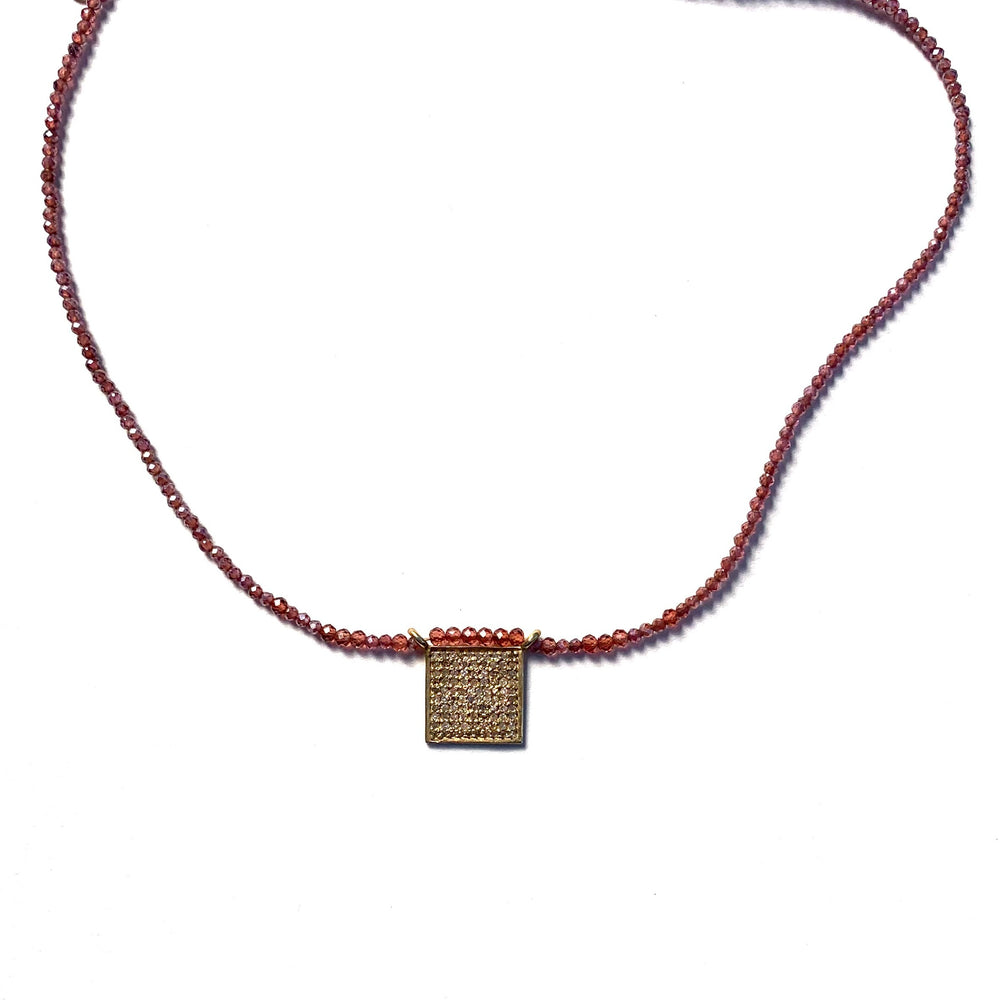 Pave diamond, gold + rhodolite necklace