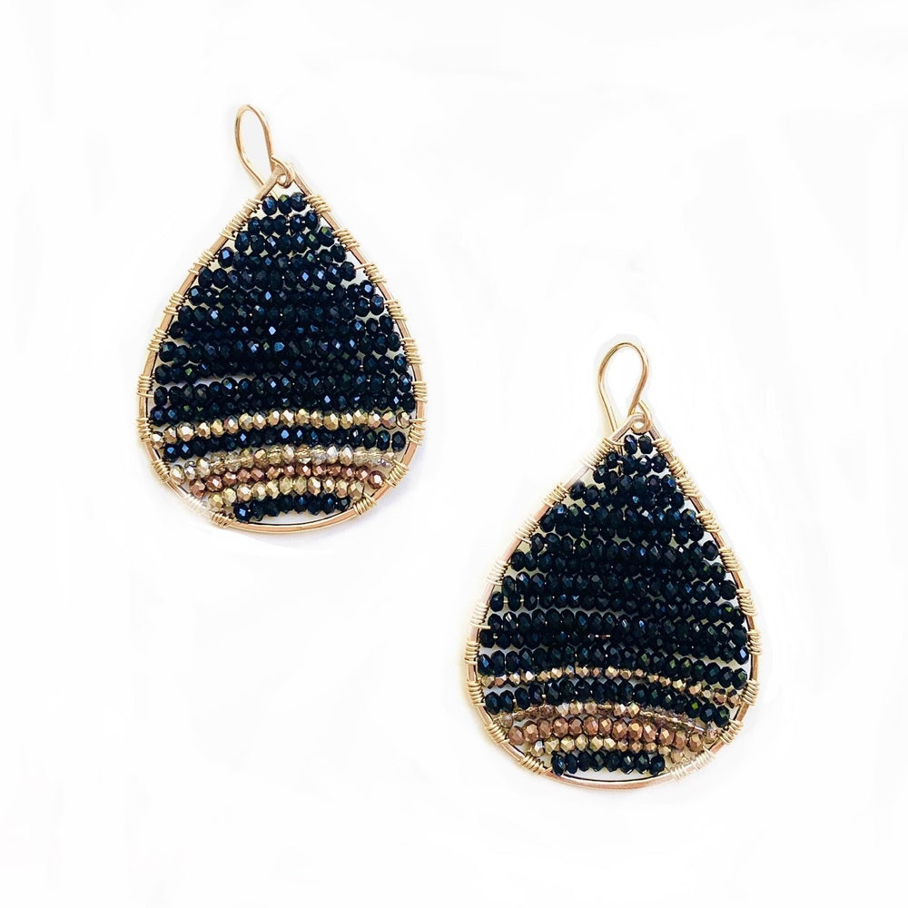 gold teardrops in black ombre