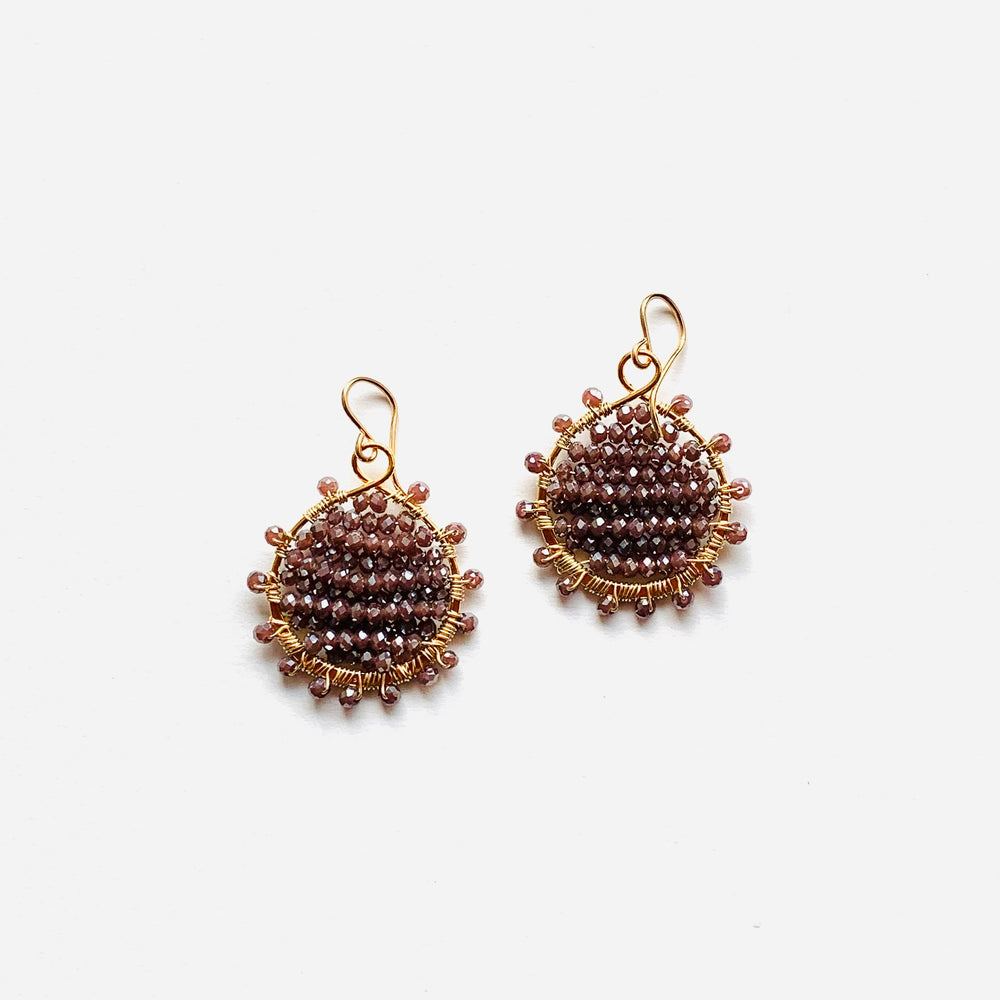 Gold sunburst earrings in raisin