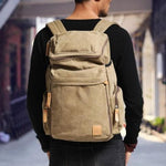 Man Carrying Classic Canvas Backpack