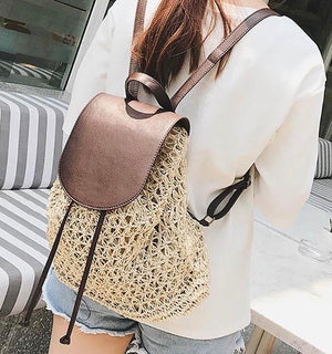 Woman Wearing Straw Backpack